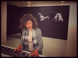 Kris Devitte's photo of me playing in front of his B&W photos